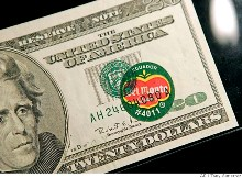 Twenty dollar note with a Del Monte sticker printed over it...
